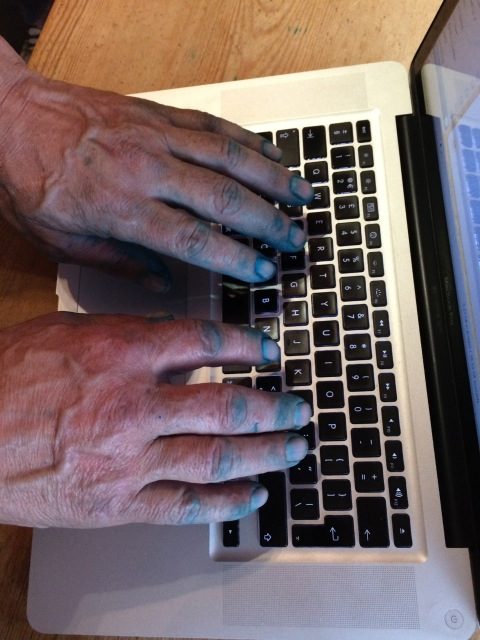 Photo of the hands of a farmer straight from chicken vaccine to keyboard