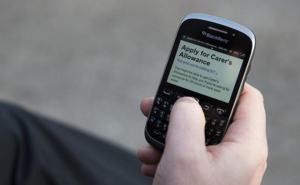 Image of phone with Carer's Allowance service