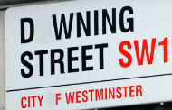 Modified Downing Street sign with letter Os removed. Original image by Sergeant Tom Robinson RLC MOD from Wikipedia Commons