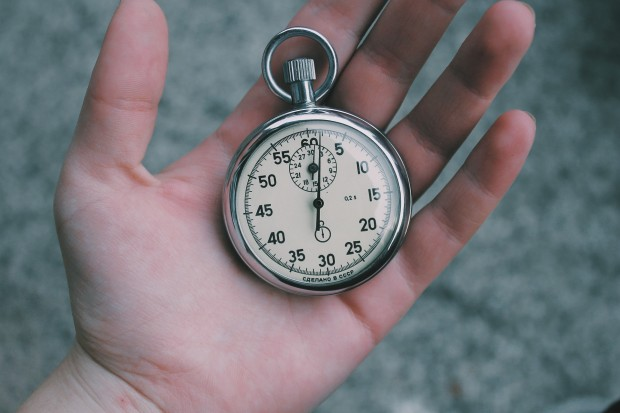 photo of stop watch in hand