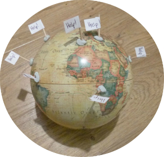Photo of globe with flags saying help
